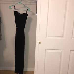 Black strapless jumpsuit with half sheer leg